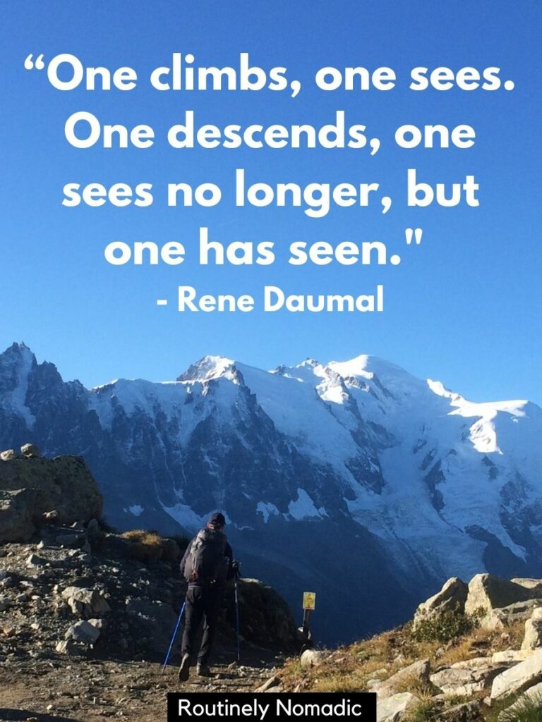Man walking on rocky path towards mountains with a inspirational mountain quotes by Rene Daumal on top