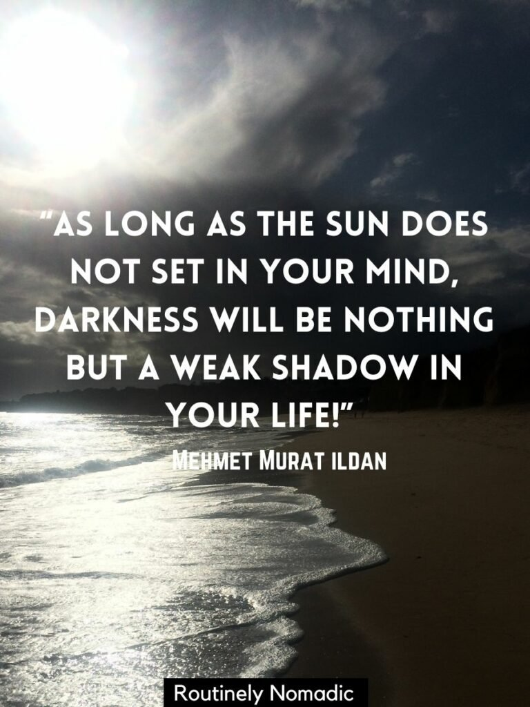 The sun shining on waves on a beach with a inspirational sunset quotes by Mehmet Murat Ildan