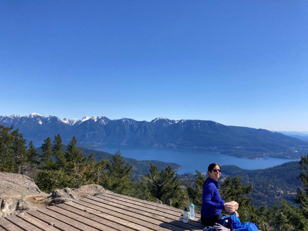 Woman at Mount Gardner viewpoint on Bowen Island BC