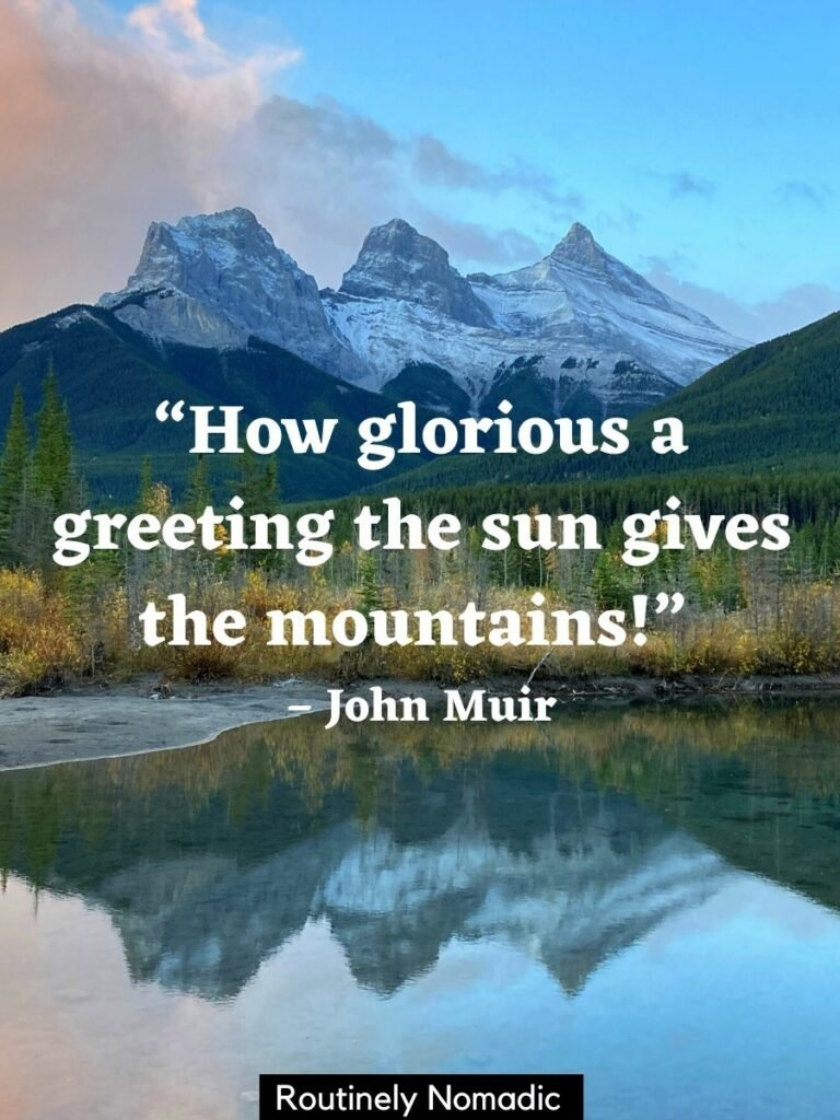 Three mountain peaks reflected in a stream at sunrise with a mountain view quotes that reads how glorious a greeting the sun gives the mountains
