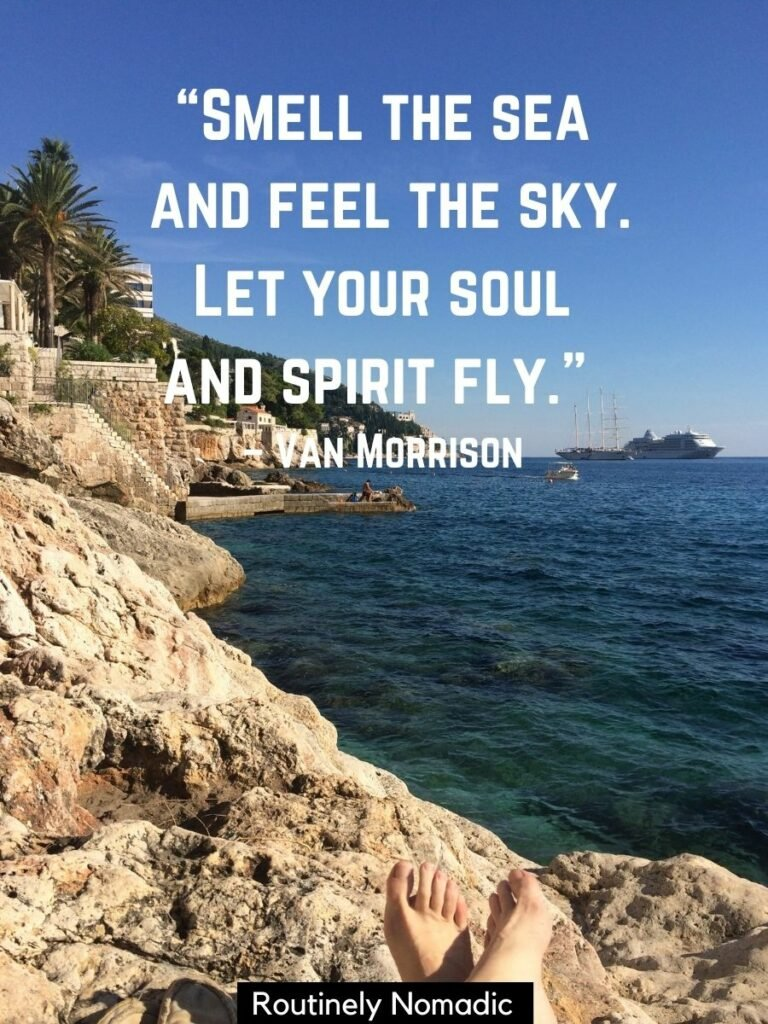 Rocky coastline and the sea with a quotes about sea and sky that reads smell the sea and feel the sky, let your soul and spirit fly by Van Morrison