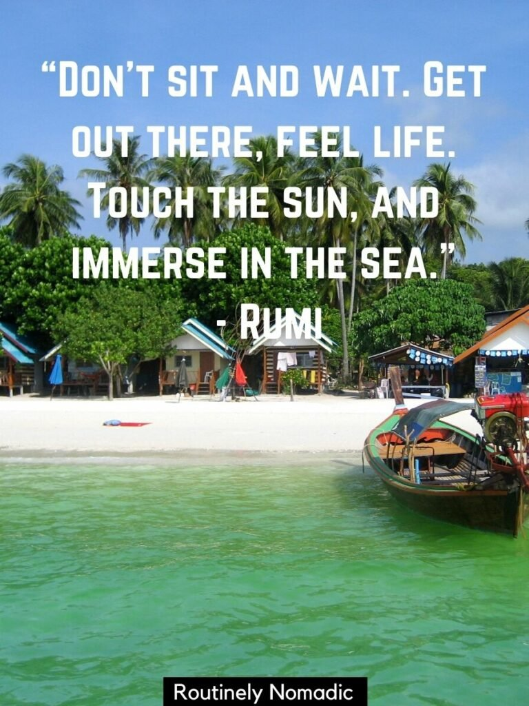 Green ocean water and a white beach with small cabins lining it with a sun quotes that reads don't sit and wait. Get out there, feel life. Touch the sun, and immerse in the sea