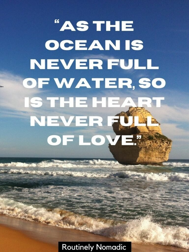 A rock in the ocean and waves on the beach with a Romantic quotes about sea and love that reads as the ocean is never full of water, so is the heart never full of love