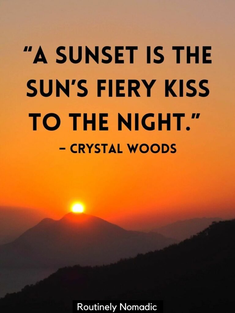 Orange sky with the sun setting behind a mountain with a romantic sunset quotes that reads a sunset is the sun's fiery kiss to the night by crystal woods