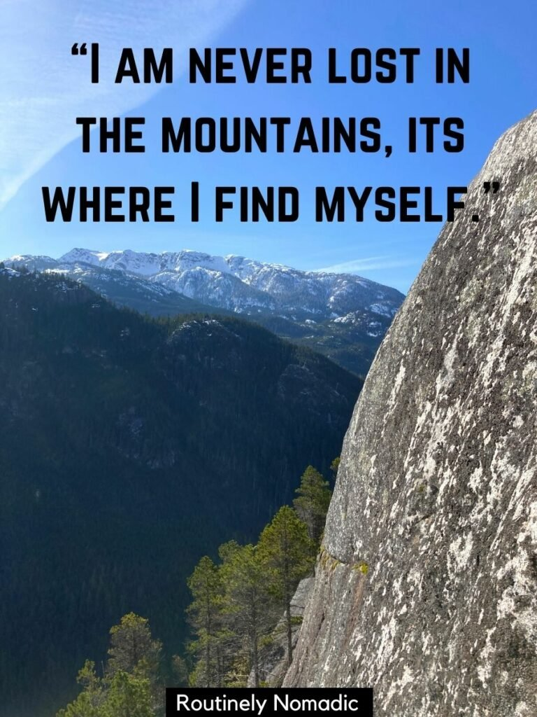 The granite side of a cliff with trees and mountains and a short mountain quotes for instagram on top that reads I am never lost in the mountains its where I find myself.