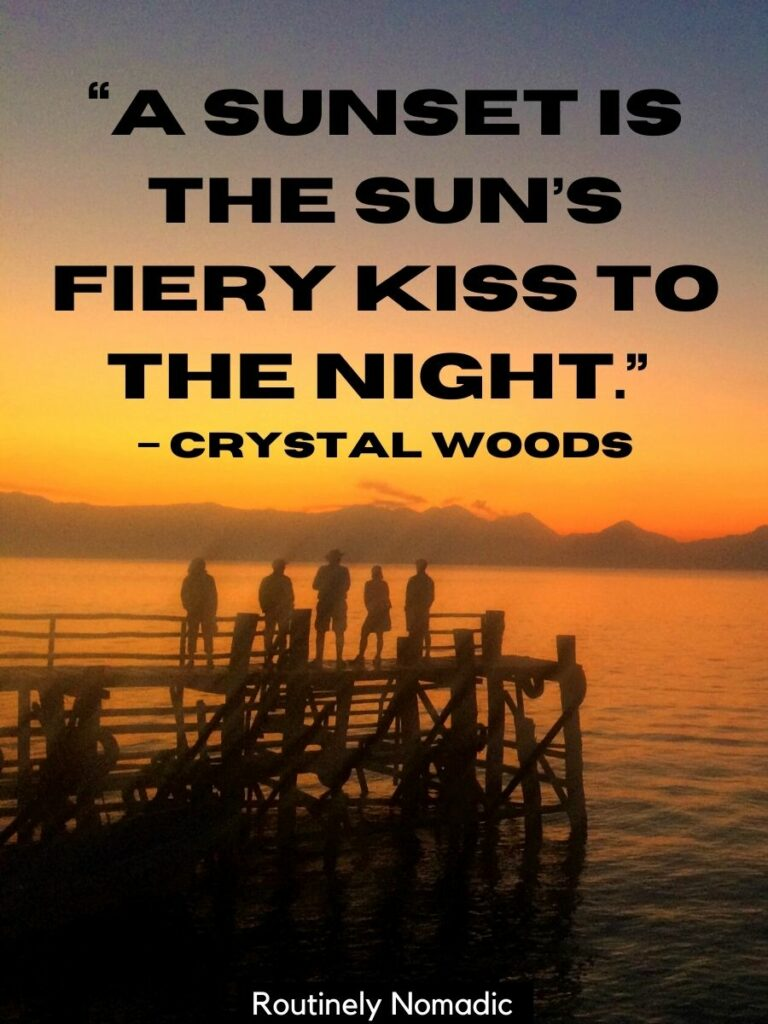 Five people standing on a dock at sunset with a simple sunset quotes for Instagram that reads a sunset is the sun's fiery kiss to the night