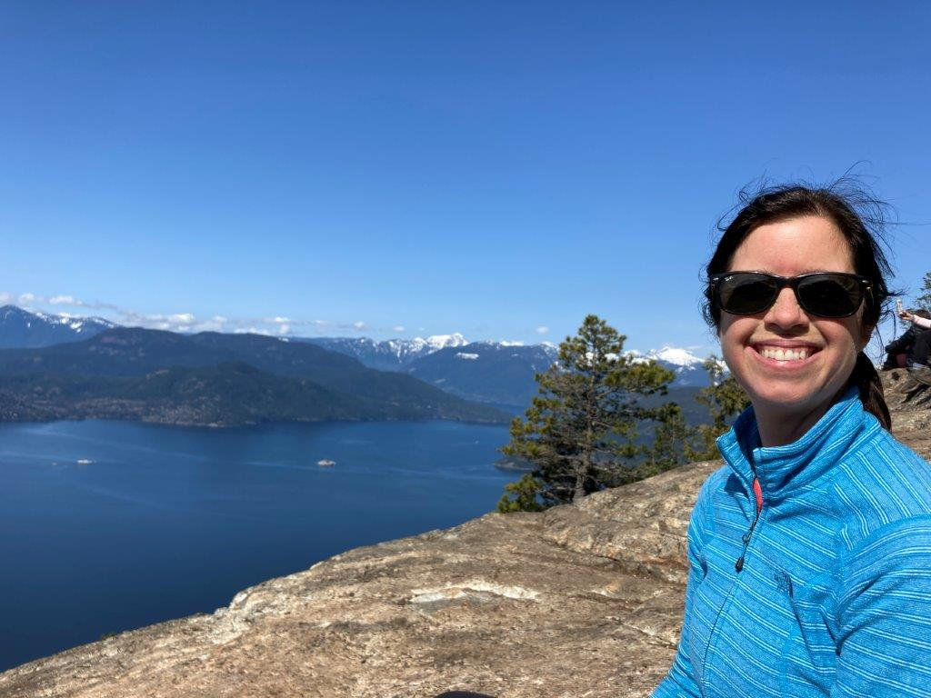 Woman in front View of the islands in the Howe Sound from the Tunnel Bluffs hike viewpoint