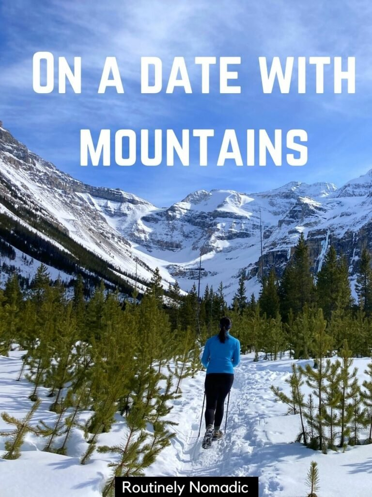 Woman walking on snowy path towards mountains with a funny hiking captions that reads on a date with mountains