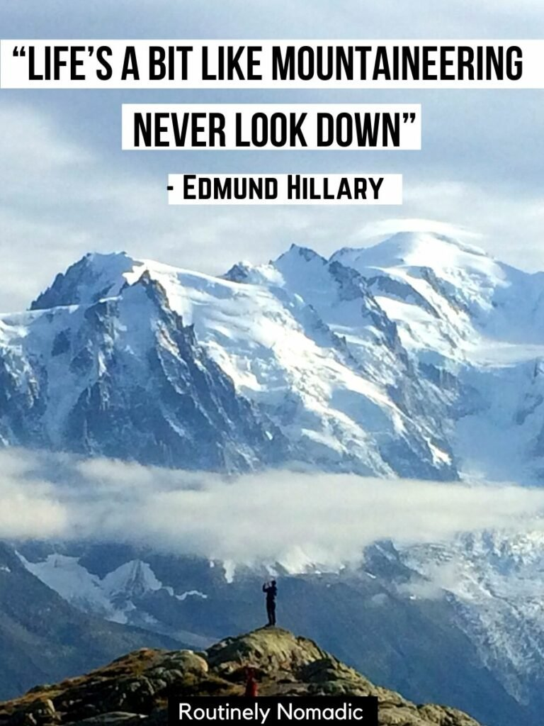Someone standing on a hill looking at snow covered mountains with a funny mountain quotes that reads life's a bit like mountaineering never look down by Edmund Hillary