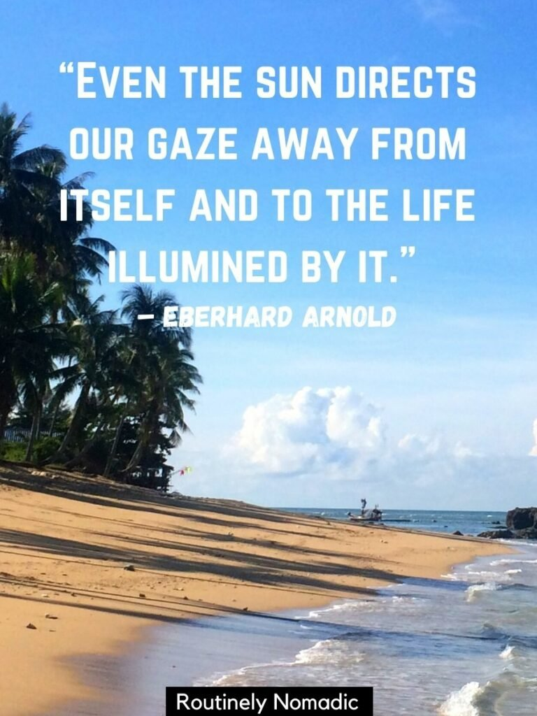 Waves rolling onto a beach with palm trees and a quotes sun that reads even the sun directs our gaze away from itself and to the life illumined by it
