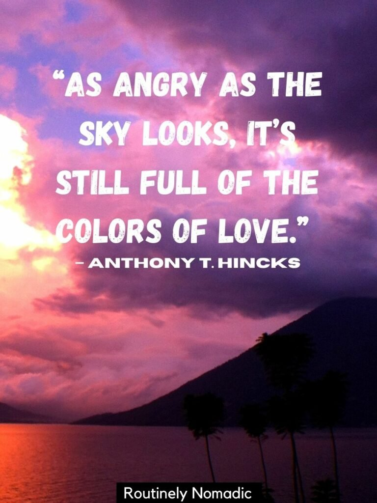 Purple clouds beside a volcano with a sunset love quotes that reads as angry as the sky looks its still full of the colors of love by Anthony T. Hincks