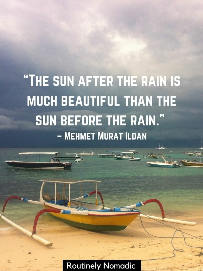 Boat on the beach with dark clouds behind and a after rain quotes on top