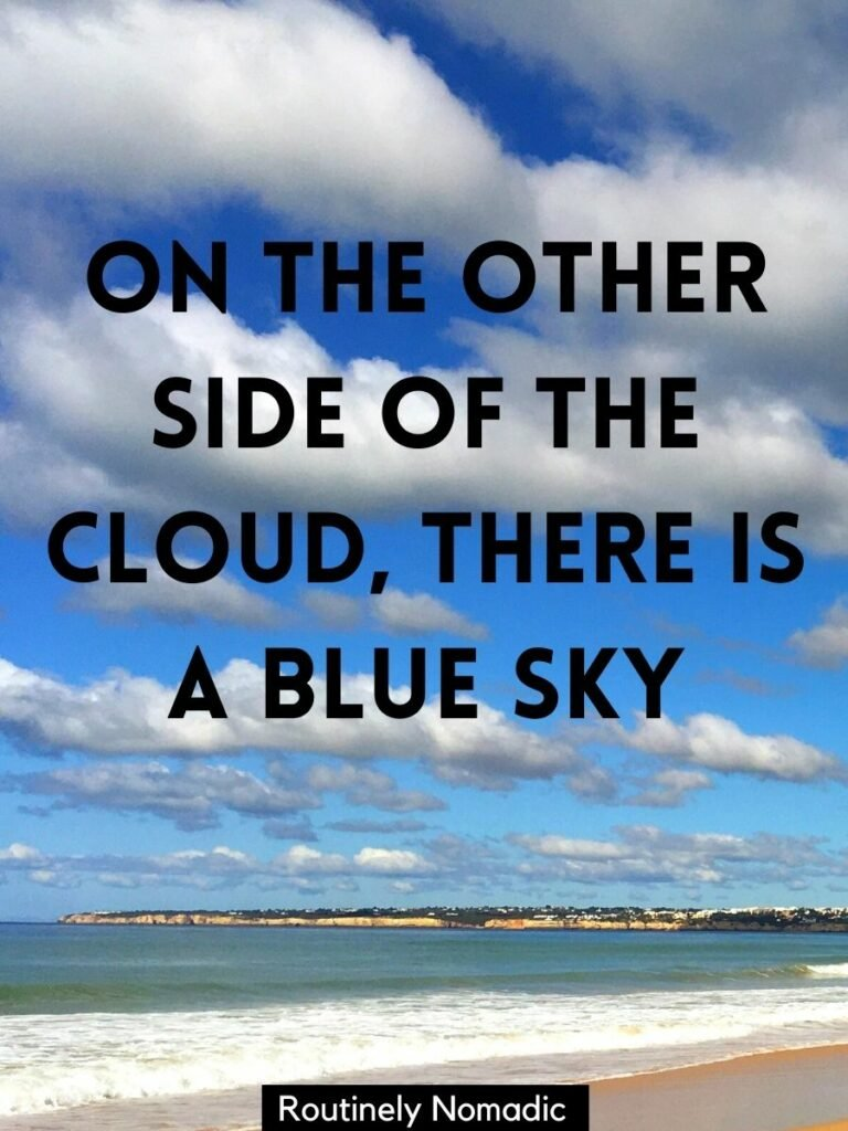 Beach and ocean with a cloudy sky and a caption about sky and clouds that reads on the other side of the cloud, there is a blue sky