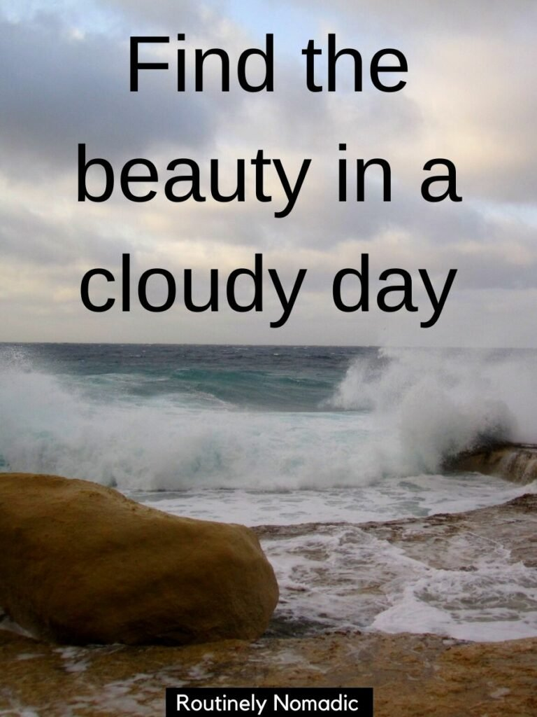 Ocean waves crashing into rocks and a caption for cloudy weather that reads find the beauty in a cloudy day