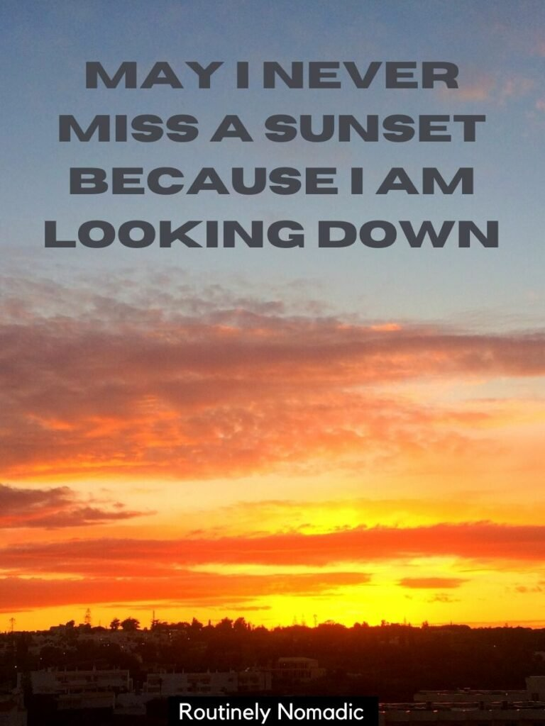 Sunset sky with a captions on sunsets that reads may I never miss a sunset because I am looking down
