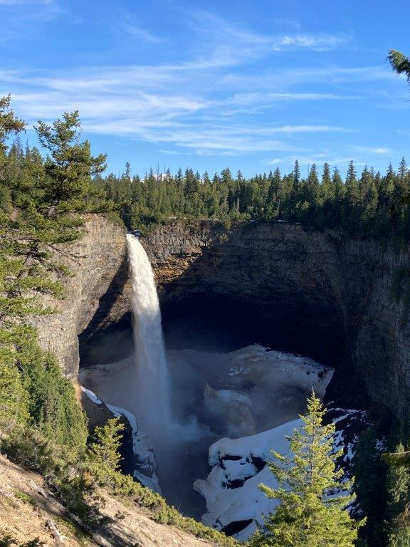 Helmcken Falls with snow around the bottom in Clearwater BC Wells Grey Park