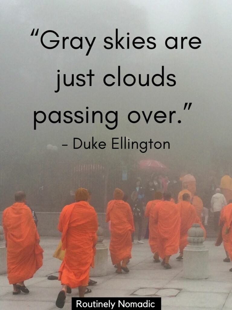 Monks in orange robes walking through clouds with a cloudy skies quotes that reads gray skies are just clouds passing over