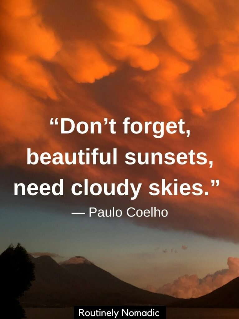 Orange clouds at sunset with volcanoes and cloudy sky quotes that reads don't forget, beautiful sunsets need cloudy skies by Paulo Coelho