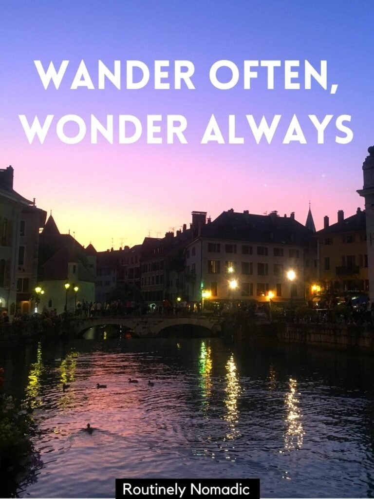 River running through a town at sunset with a cute river captions that reads wander often, wonder always