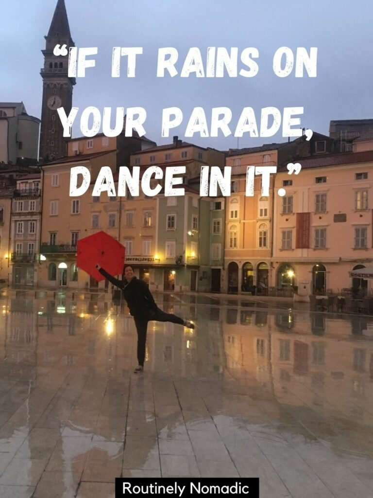 Woman with umbrella in town square with a dance in the rain quotes that reads if it rain on your parade dance in it