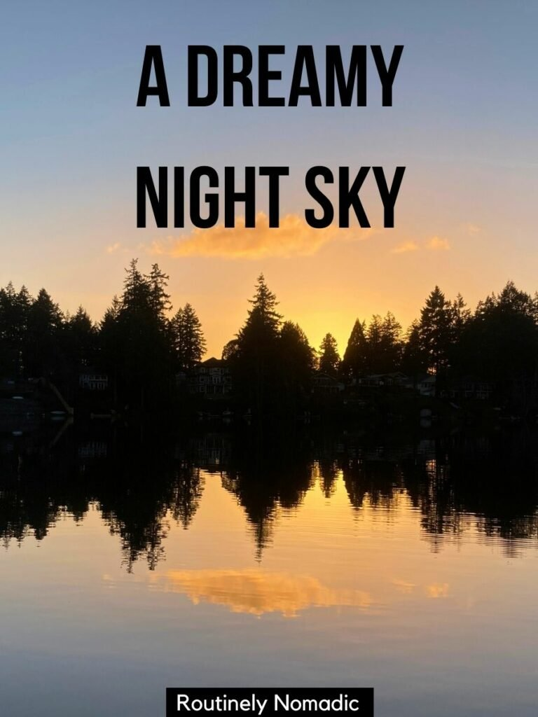 Trees reflected in a lake at sunset with a evening sky captions that reads - a dreamy night sky