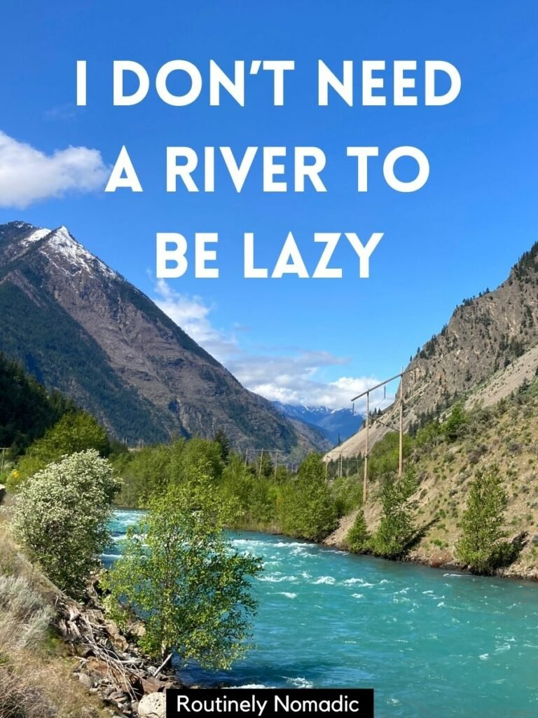 Blue river with mountain behind and a funny river captions that reads I don't need a river to be lazy