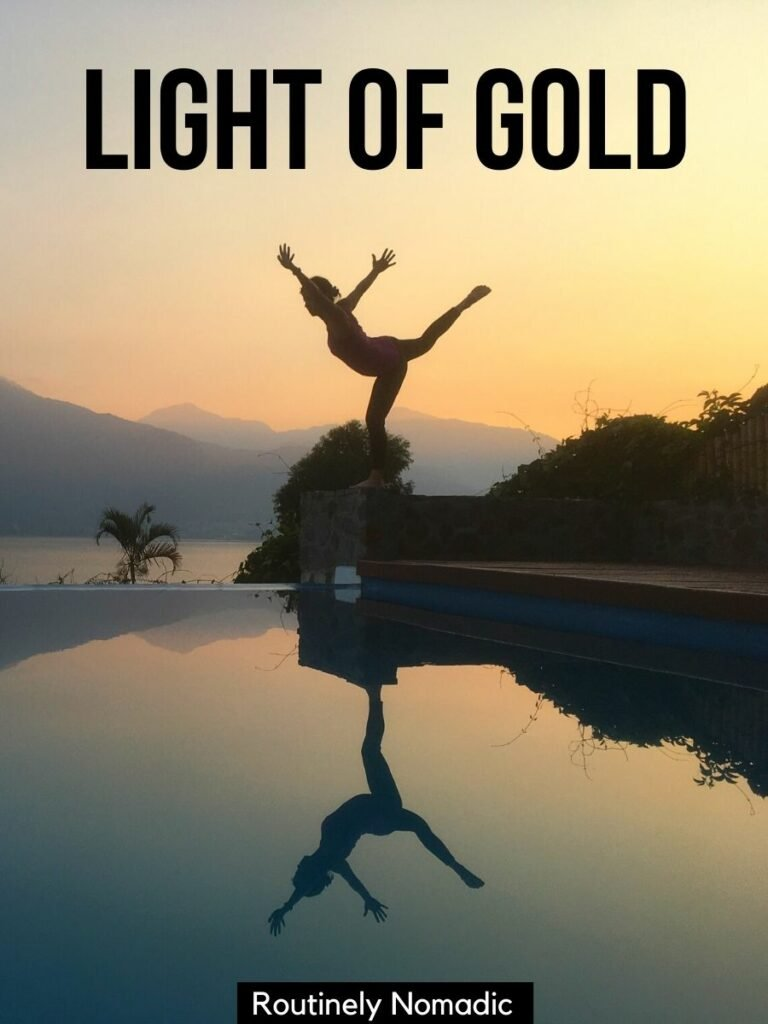 Woman reflected in infinity pool with a golden hour captions that reads light of gold