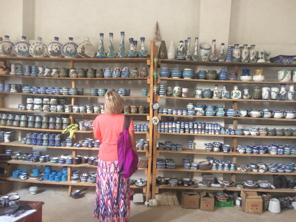 woman shopping for pottery in a village on Lake Atitlan