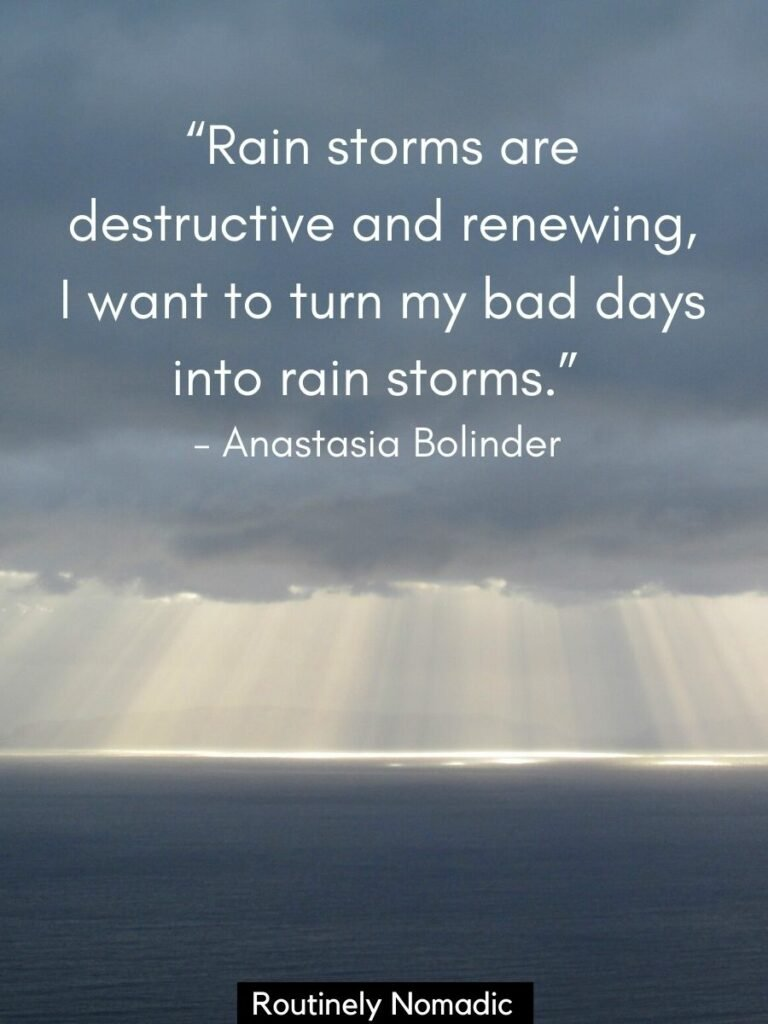 Clouds over the water with quotes about rain storms by Anastasia Bolinder