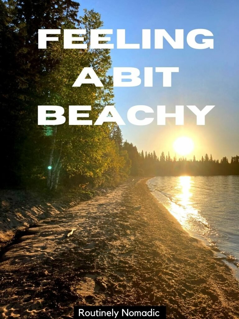 lake beach lined with trees at sunset and a lake puns for Instagram caption that reads feeling a bit beachy