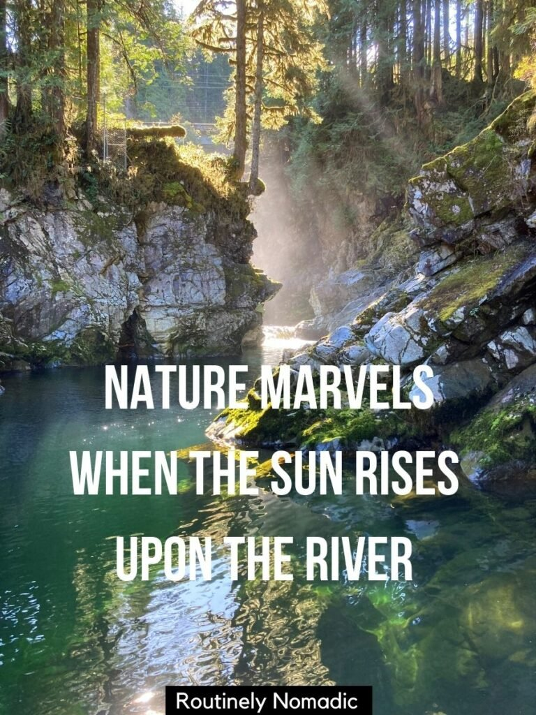 Misty morning on a green river with a nature river captions for Instagram that reads nature marvels when the sun rises upon the river