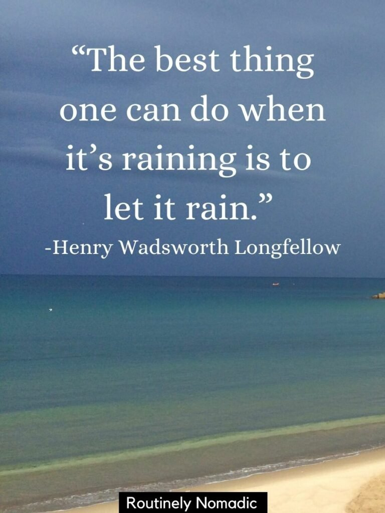 Beach and ocean with dark clouds and a positive rainy days quotes that says the best thing one can do when its raining is to let it rain