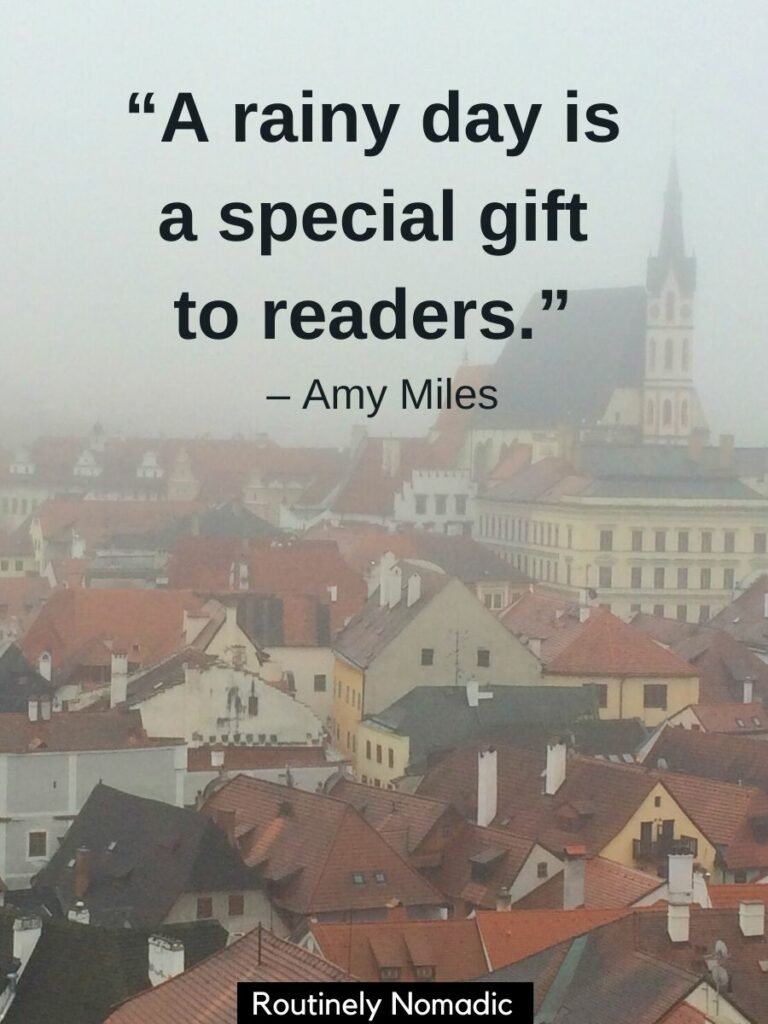 Red roofs and a church spire with a rainy day quotes that says a rainy day is a special gift to readers