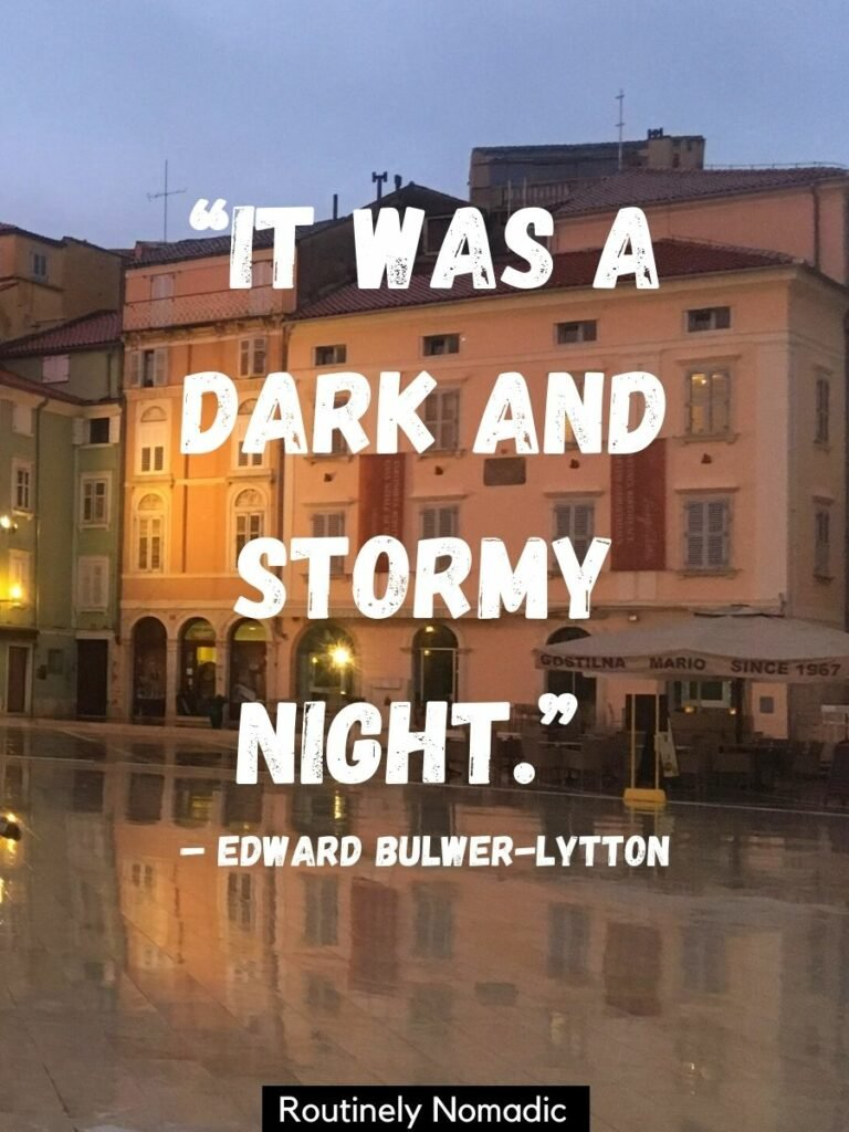 A town square relfected in the rain with a rainy night quotes that says it was a dark and stormy night