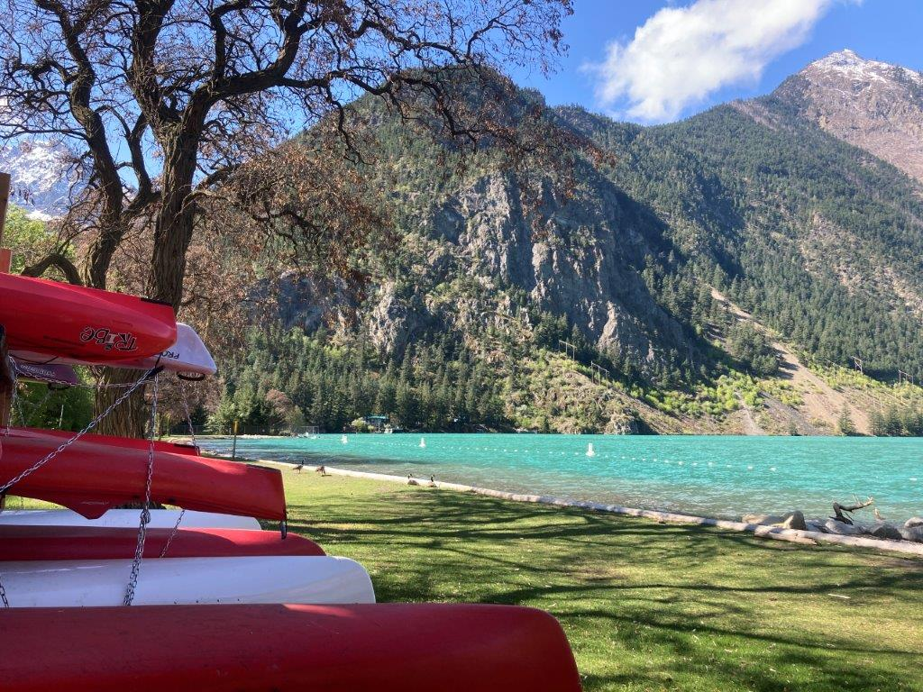 Red canoes and blue water at Seton Lake Recreation Area