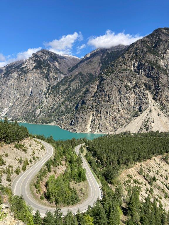 Curved road with glacier water lake and mountains at the Seton Lake hike viewpoint