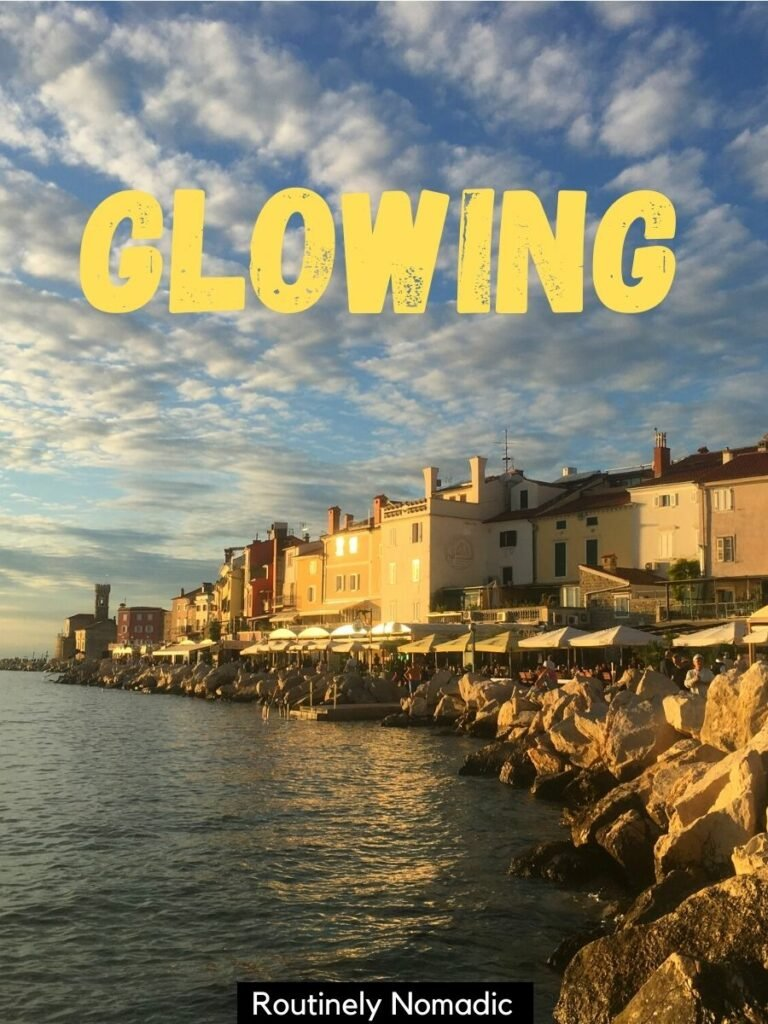Town on Piran at sunset with a short golden hour captions that reads glowing