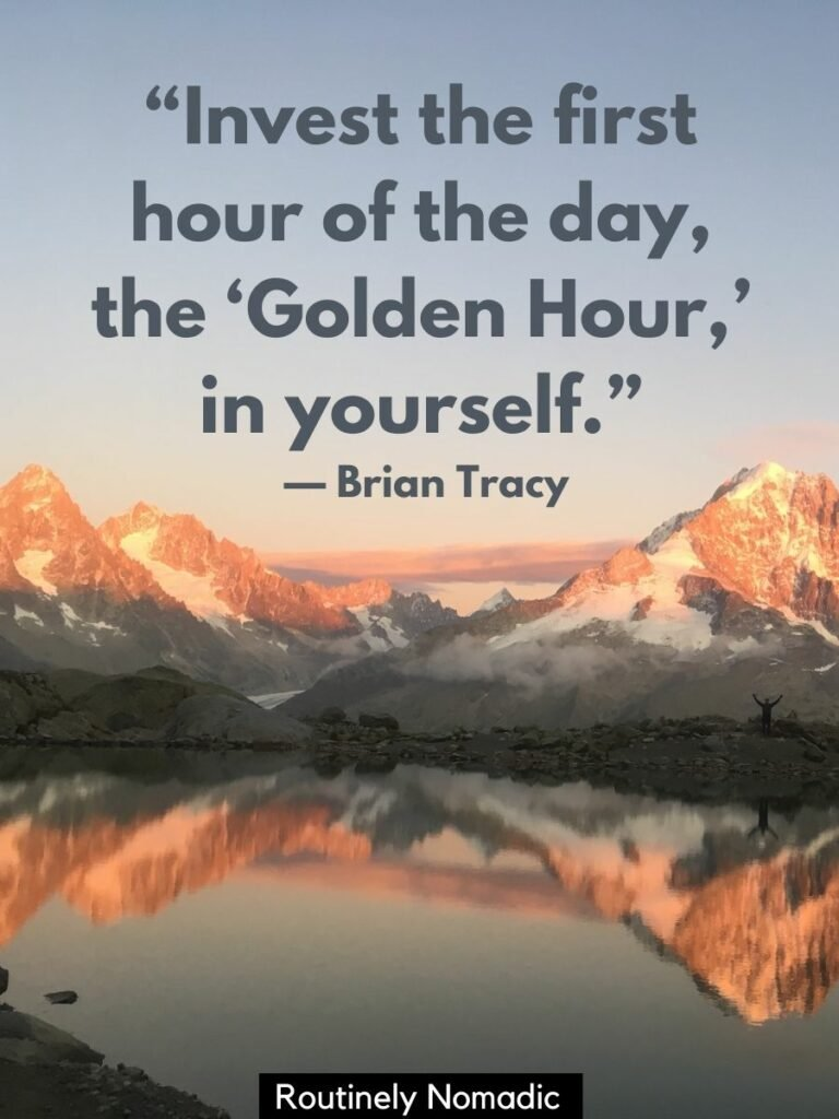 Mountains reflected in a lake at sunset with a golden hour quotes from Brian Tracy