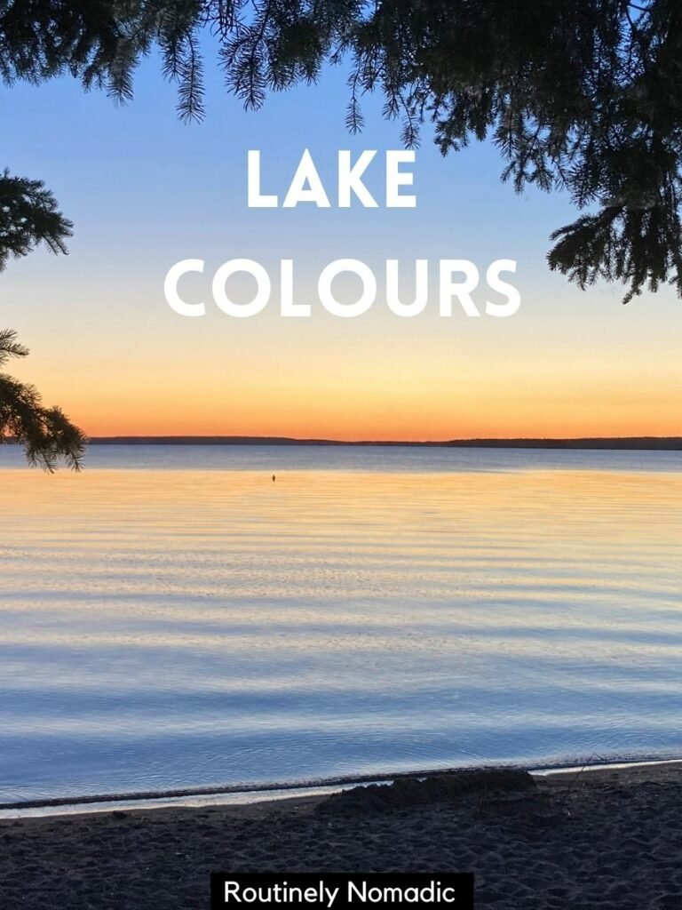 Sunset reflecting on lake framed by trees and a short lake captions that reads lake colours