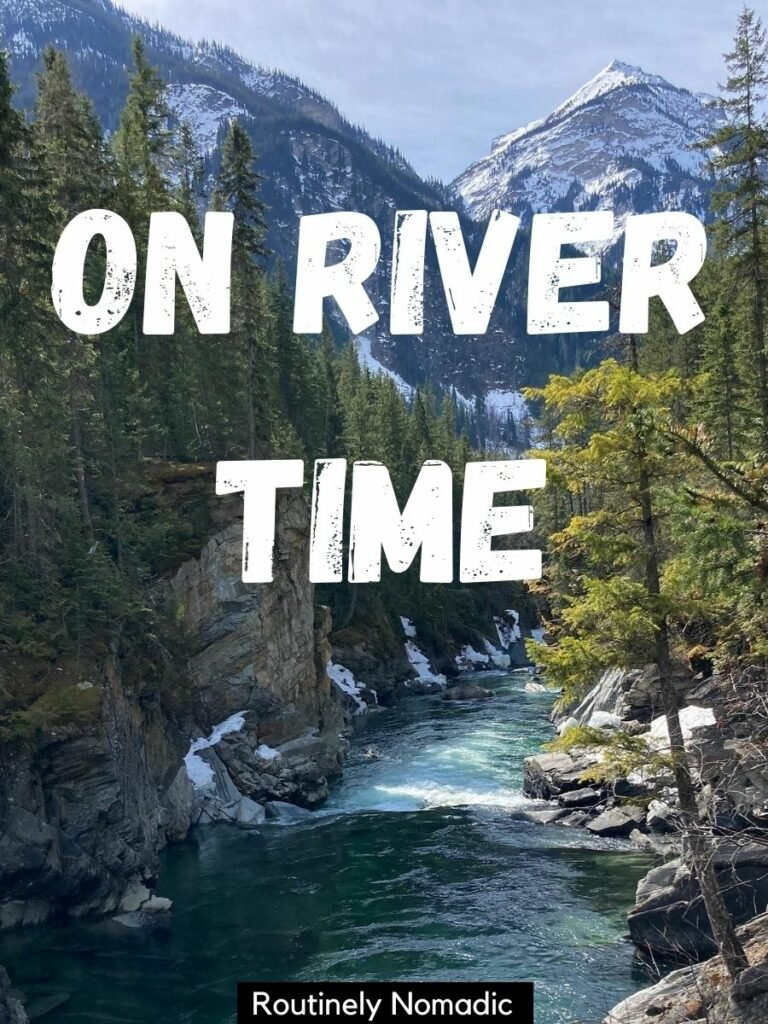 River framed by trees and backed by mountains with a short river captions that reads on river time
