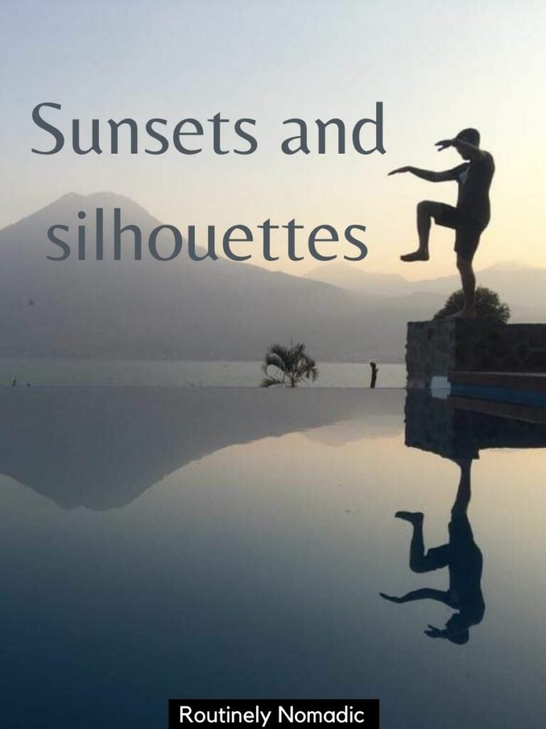 Man posing and reflected in an infinity poo and volcano in the background with a short sunset captions for Instagram that reads sunsets and silhouettes
