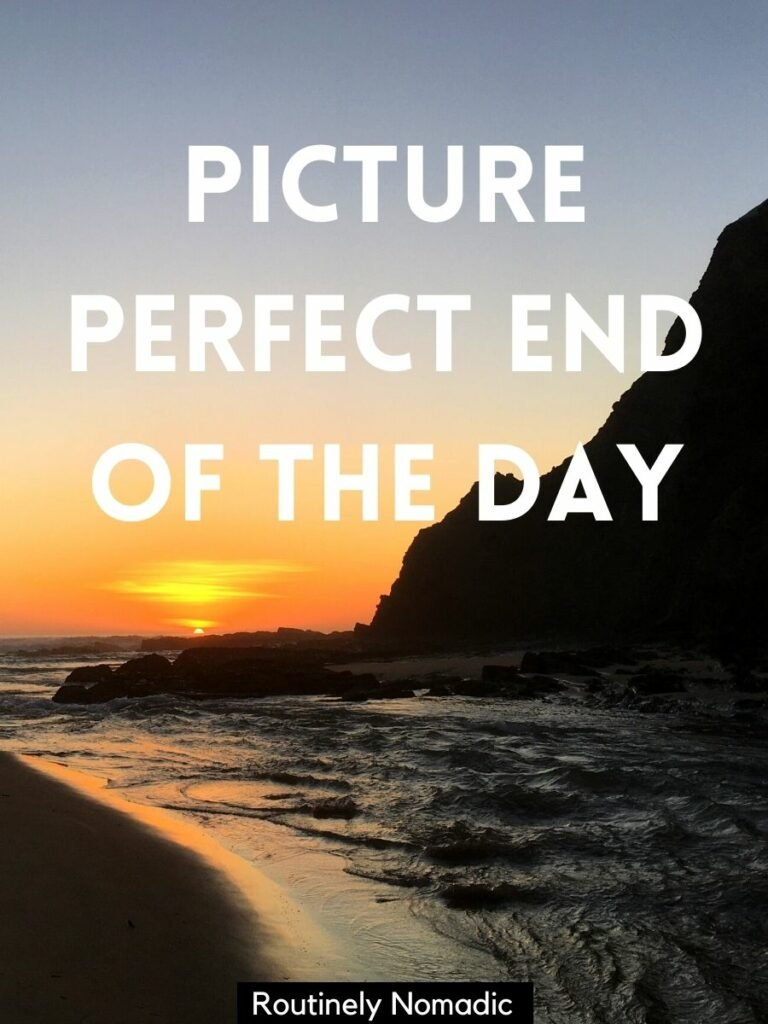 Sun setting over ocean on the beach with a sihouetted hill to the side and a sunset captions for Instagram that reads picture perfect end of the day