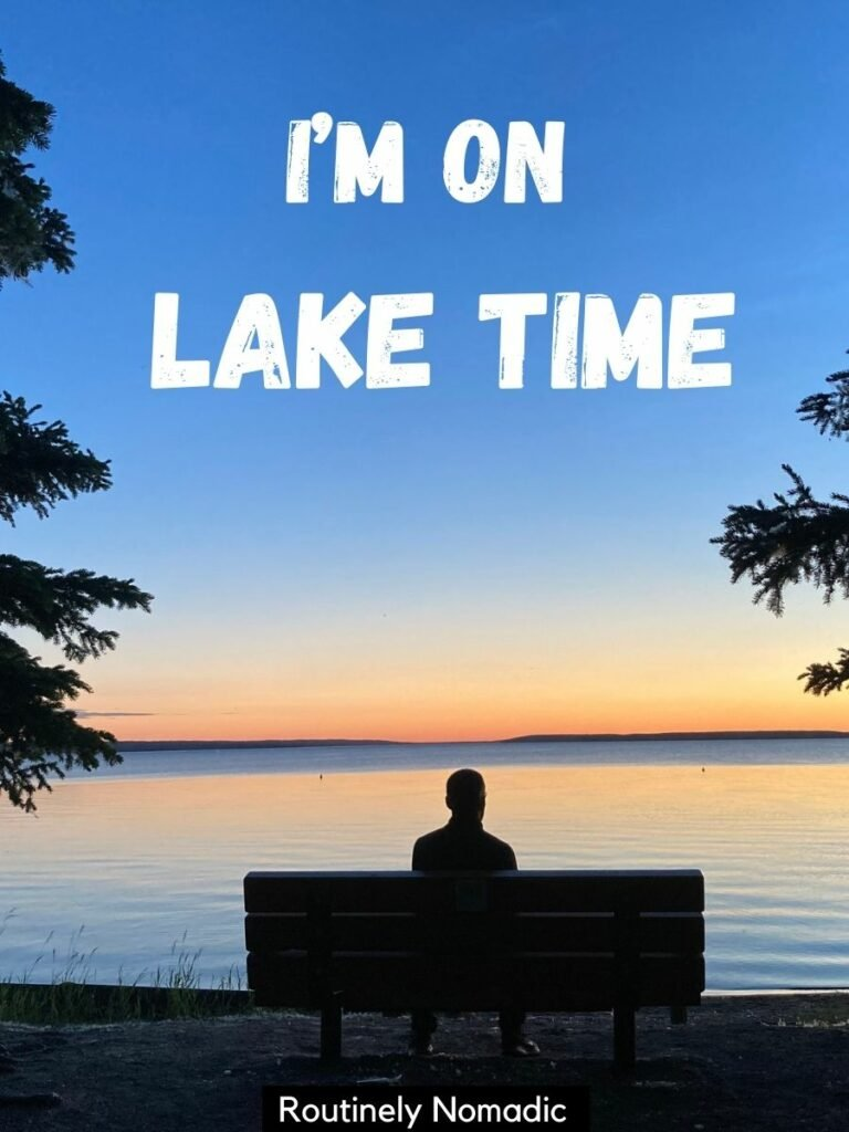man sitting on bench in front of lake at sunset with lake captions that reads I'm on lake time