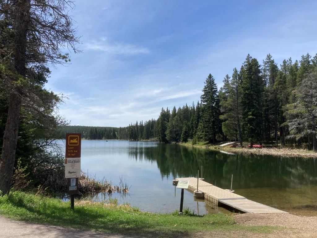 Dock and lake surrounded by pines at Cypress hills Saskatchewan