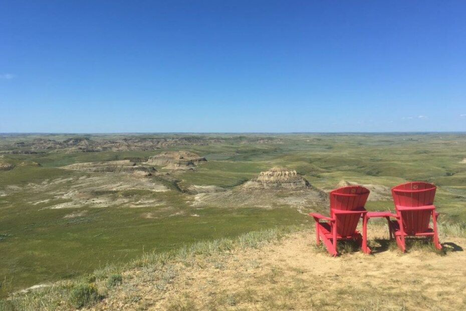 Two red chairs at a viewpoint on the Grasslands National Park Parkway