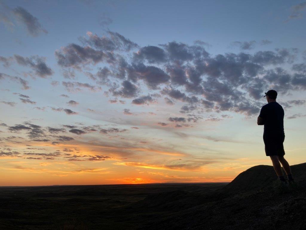 Man looking at sunset at the Grasslands National Park Saskatchewan