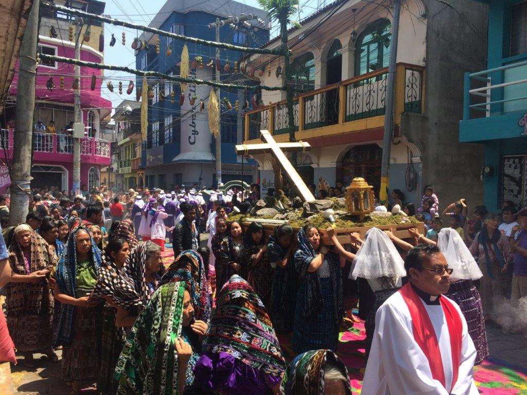 Local women carrying a cross during Semana Santa at San Pedro La Laguna Atitan