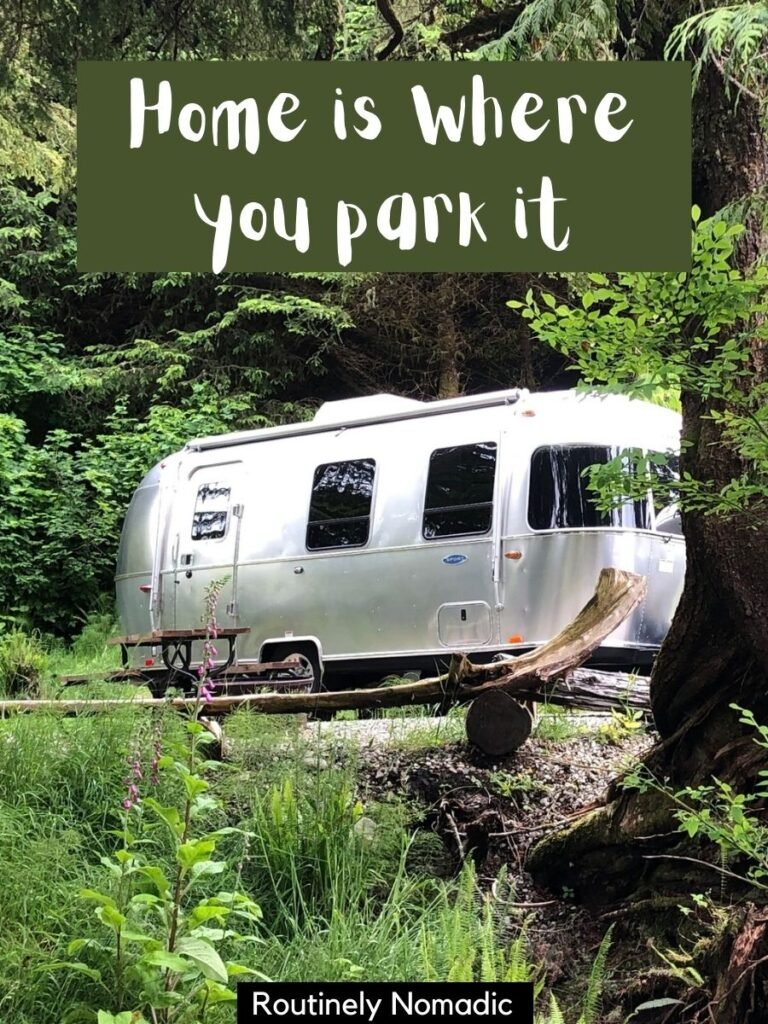 An RV in the trees with a camping Instagram captions that reads home is where you park it.