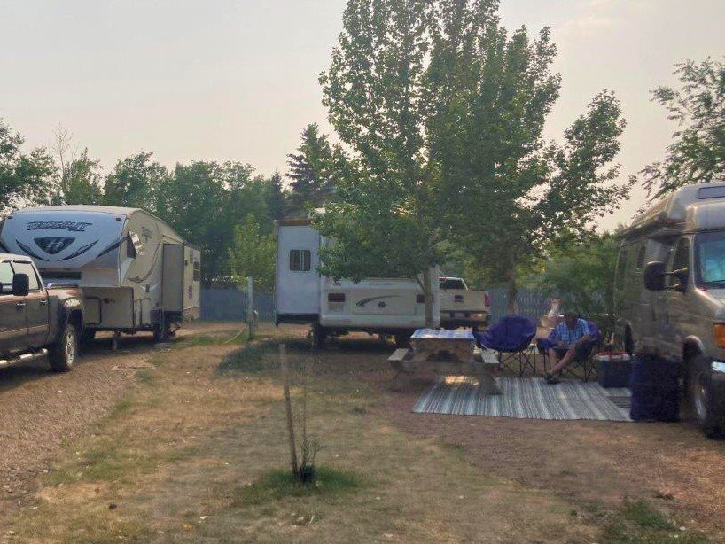 RVs in a row in a Drumheller camping site