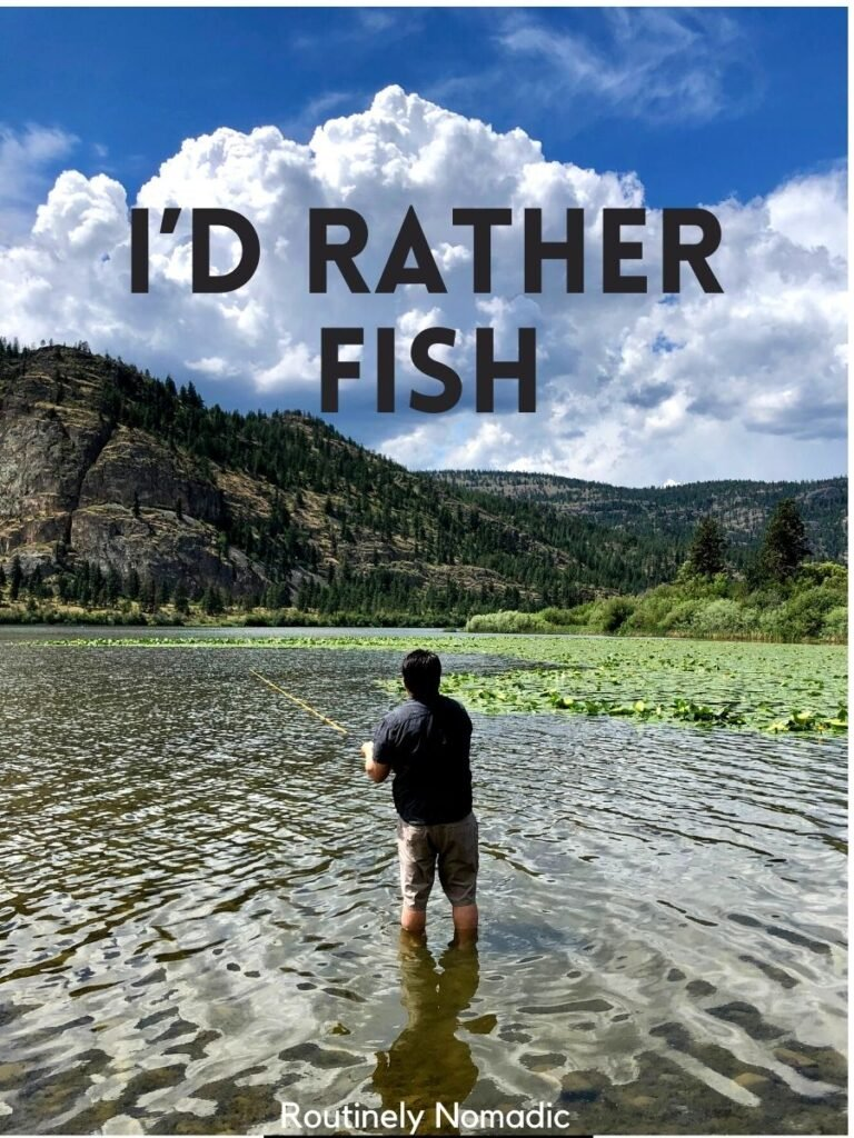 Man fishing in a lake with a hill behind and a fishing sayings that reads I'd rather fish
